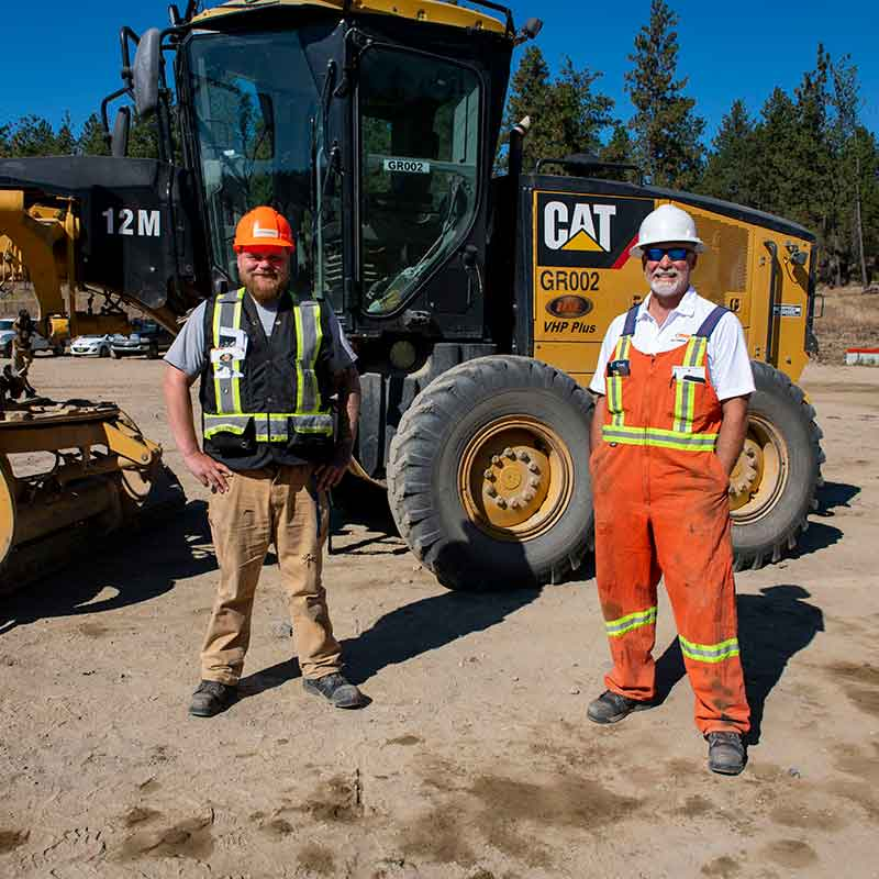 Picture of an Interior Heavy Equipment School instructor with a student at a job site