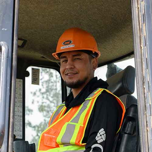 An Indigenous partner having a training at Interior Heavy Equipment Operator college