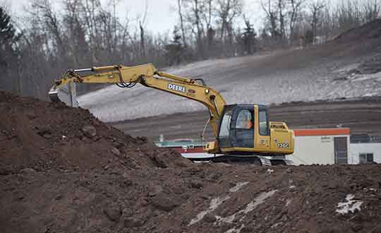 Picture of an Excavator moving boulders