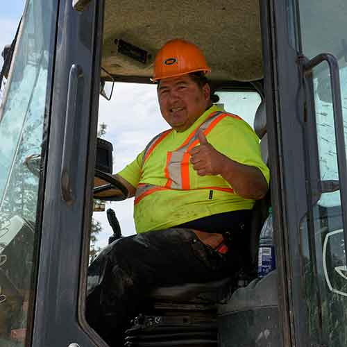 Picture of a Interior Heavy Equipment college student operating machines during training