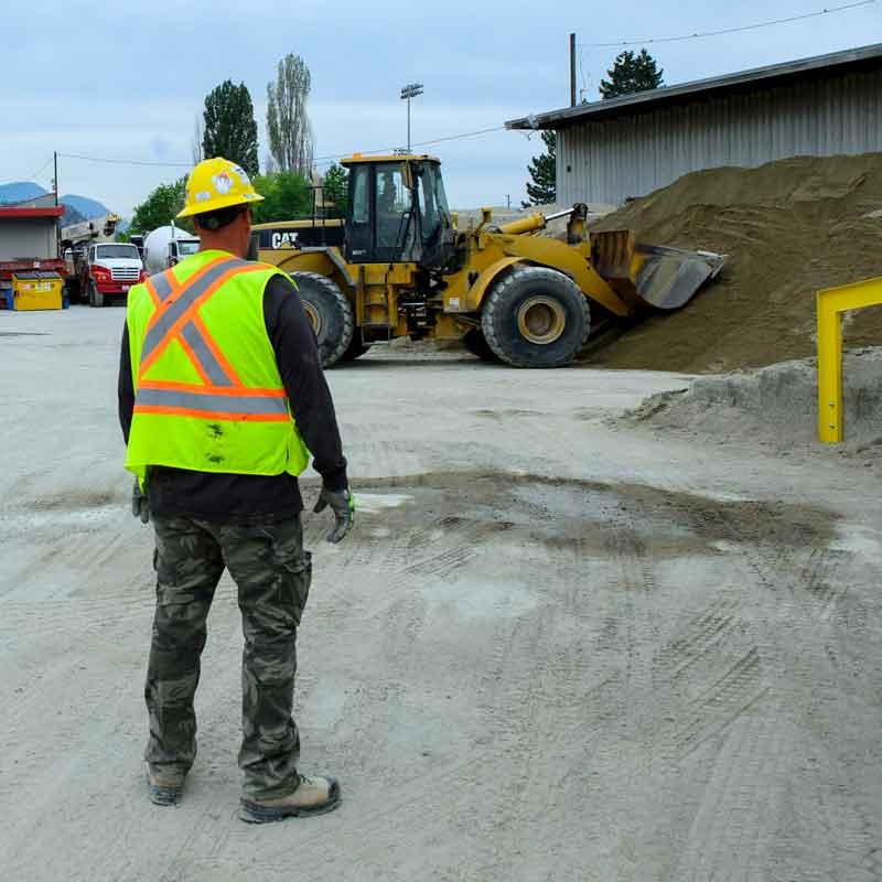 Picture of an Interior Heavy Equipment School instructor on a training site