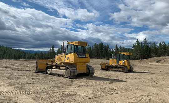 Picture of two Dozers on a training site