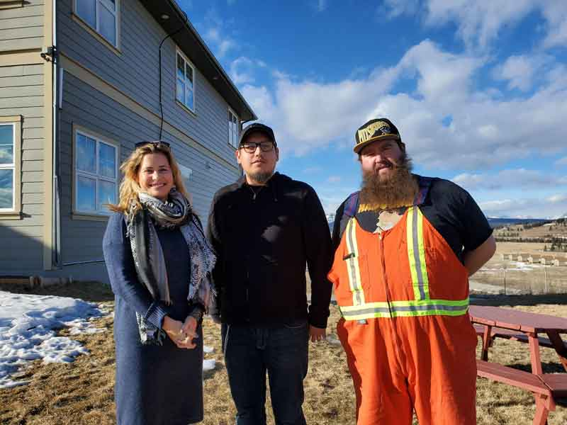 IHE remote training manager, Ron Cornforth, standing with Alden Twoyoungmen, Chiniki HRD Manager, and IHE Director of Operations, Christine Bay.