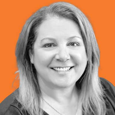 Portrait of Corinne Van De Crommenacker, Registrar/Office Manager at Interior Heavy Equipment School and part of our leadership team