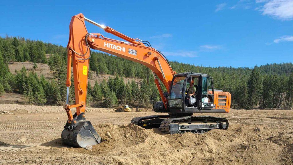 Heavy equipment operator using a Hitachi excavator